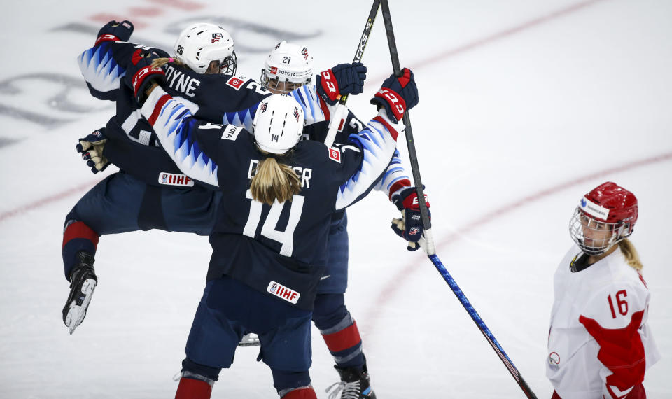 Hilary Knight, centre, of the United States, celebrates her goal with teammates Kendall Coyne Schofield, left, and Brianna Decker as Russia's Ilona Markova looks away during second period IIHF Women's World Championship hockey action in Calgary, Alberta, Tuesday, Aug. 24, 2021. (Jeff McIntosh/The Canadian Press via AP)