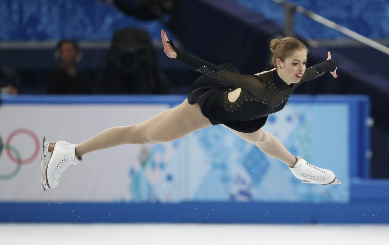 Italy's Carolina Kostner competes during the figure skating women's free skating program at the 2014 Sochi Winter Olympics, February 20, 2014. REUTERS/Lucy Nicholson (RUSSIA - Tags: OLYMPICS SPORT FIGURE SKATING)