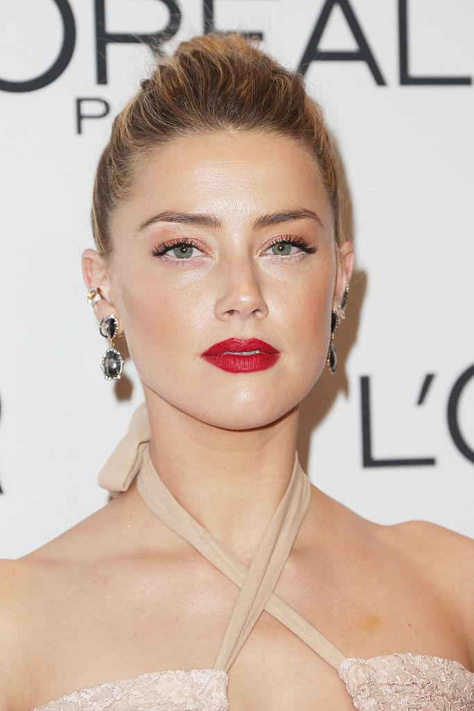 Amber Heard has penned a heartfelt open letter about domestic abuse [Photo: Getty]