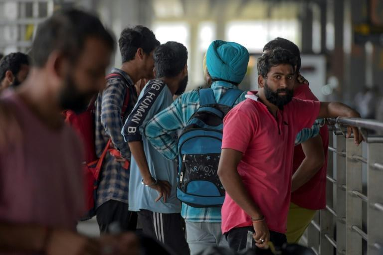 Indian nationals arrive at Indira Gandhi International airport after being deported from Mexico (AFP Photo/STR)
