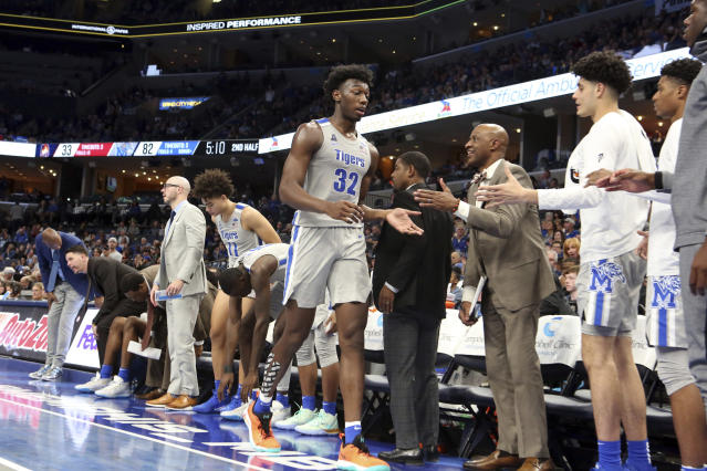 Memphis' James Wiseman (32) is congratulated by teammates as he takes a break during the second half of an NCAA college basketball game against Illinois-Chicago, Friday, Nov. 8, 2019, in Memphis, Tenn. (AP Photo/Karen Pulfer Focht)