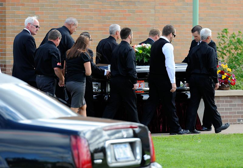 Pallbearers help roll the casket of sprint car driver Kevin Ward Jr. at South Lewis Senior High School on August 14, 2014 in Turin, New York (AFP Photo/Rich Barnes)