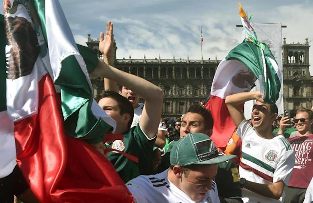 Mexico fans gathered in the capital's main Zocalo square erupt as their team defeated Germany at the World Cup (AFP Photo/RODRIGO ARANGUA)