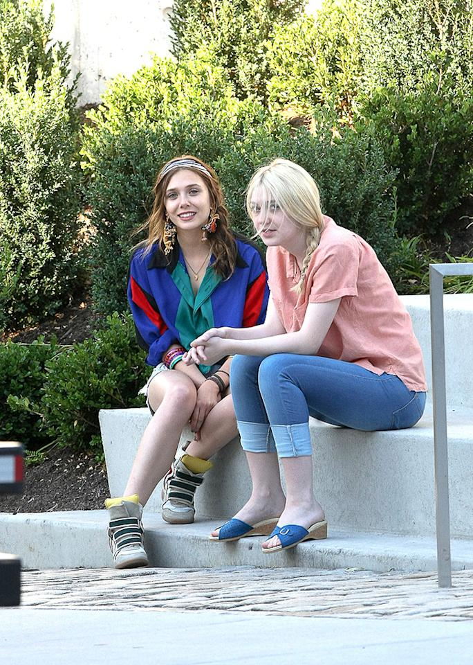 Elizabeth Olsen along with co-stars Dakota Fanning and Boyd Holbrook (not pictured) sitting around the set of 'Very Good Girls' in Brooklyn New York on Monday morning.