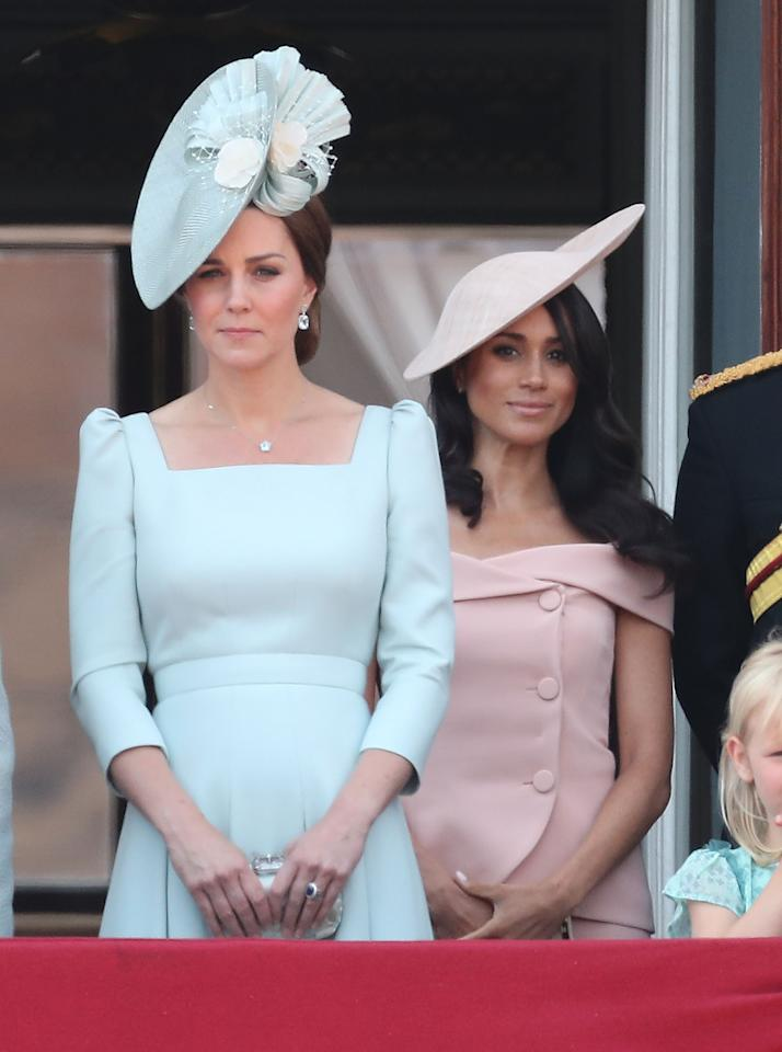 <p>Trooping of the Colour was undoubtedly Meghan's first big royal outing, and for the occassion she decided on a pink Carolina Herrera skirt suit. Some suggested the cold-shoulder shape of the dress was a breach of royal protocol. To accessorise, she recycled the same bespoke Philip Treacy hat and wore a Carolina Herrera clutch. <em>[Photo: Getty]</em> </p>