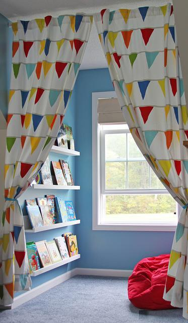 """<div class=""""caption-credit""""> Photo by: These Moments of Mine</div><div class=""""caption-title"""">My Mini-Library</div>An easy way to section off the reading nook is with cute curtains to close when things get messy. It's really just a mini-library in a room, so it makes good practice for your kids to start going to the library when they get older! <br> <i><a rel=""""nofollow noopener"""" href=""""http://blogs.babble.com/family-style/2012/08/13/25-cute-and-cozy-kids-reading-nooks/#curtain-dividers"""" target=""""_blank"""" data-ylk=""""slk:Get the inspiration here"""" class=""""link rapid-noclick-resp"""">Get the inspiration here</a></i> <br>"""