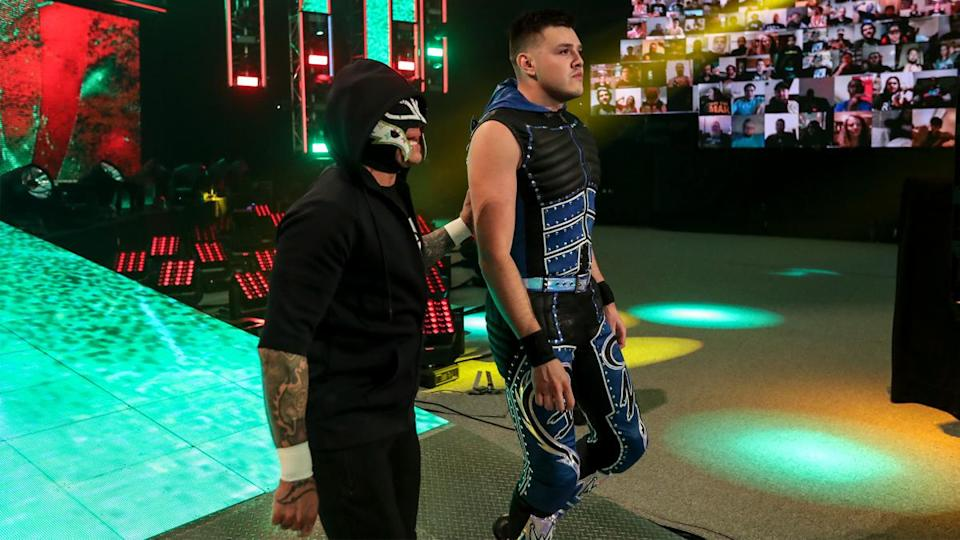 Rey and Dominik Mysterio walk to the ring before Dominik's match against Seth Rollins at SummerSlam. (Photo credit: WWE)