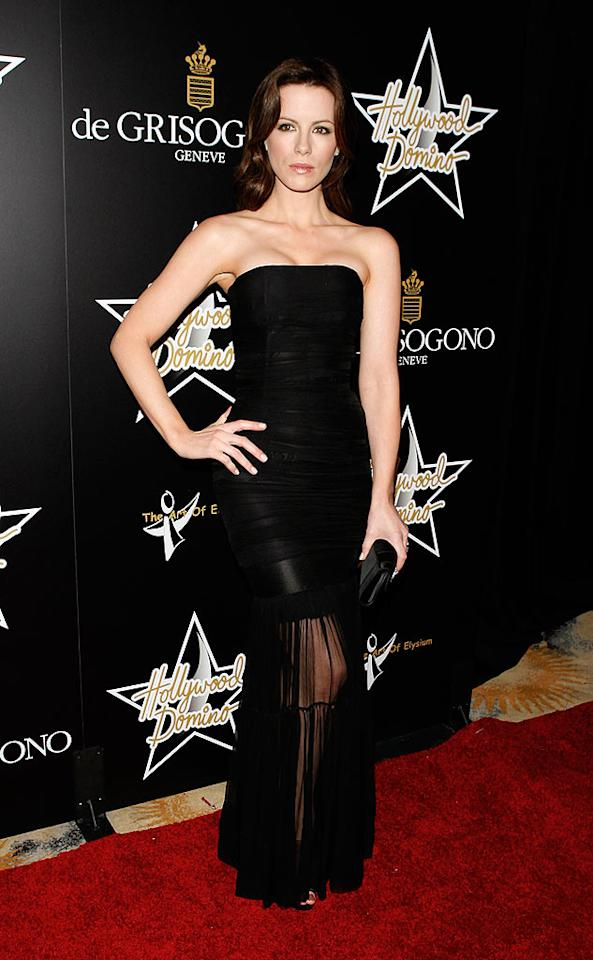 "Kate Beckinsale strikes a fierce pose in her form fitting gown with sheer bottom that teases just a hint of leg. Jean Baptiste Lacroix/<a href=""http://www.wireimage.com"" target=""new"">WireImage.com</a> - February 21, 2008"