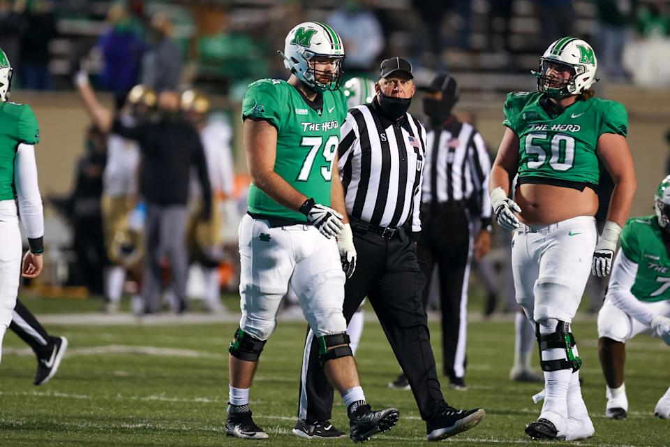 Marshall offensive lineman Josh Ball (79) is escorted to the sideline by an official after being ejected during the fourth quarter of the 2020 Conference USA championship game. (Photo by Frank Jansky/Icon Sportswire via Getty Images)