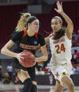 FILE - In this March 16, 2018, file photo, Princeton's Bella Alarie, left, works in the post as Maryland's Stephanie Jones (24) defends during the second half of a first-round game in the NCAA women's college basketball tournament in Raleigh, N.C. The Dallas Wings selected Alarie with the fifth pick in the WNBA basketball draft Friday, April 17, 2020. (AP Photo/Ben McKeown, File)