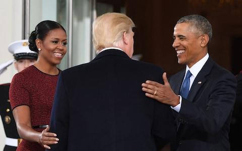Mrs Obama said her body 'buzzed with fury' when she saw the Access Hollywood tape of US President Donald Trump bragging about sexually assaulting women - Credit: Jim Watson /AFP