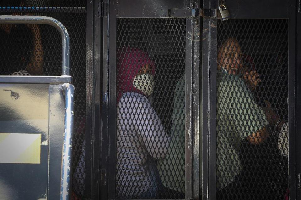 Illegal immigrants are detained by the Immigration Department following raids in Selayang Baru, Kuala Lumpur May 14, 2020. — Picture by Yusof Mat Isa