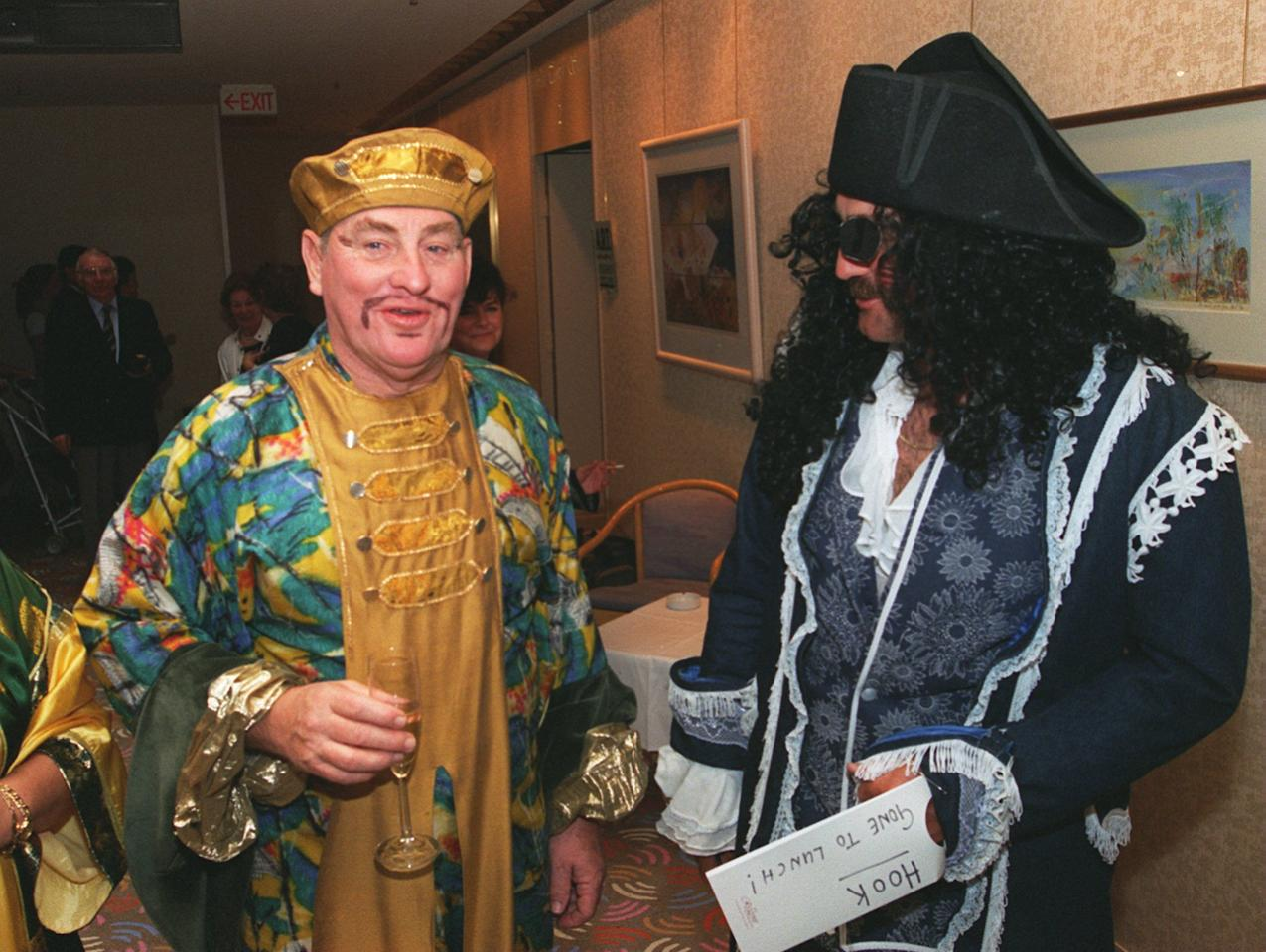 25 DEC 1994  ENGLANDS  CHAIRMAN OF THE SELECTORS RAY ILLINGWORTH (LEFT) AND GRAHAM GOOCH  IN FANCY DRESS FOR THE CHRISTMAS PARTY DURING THE SECOND TEST AGAINST AUSTRALIA IN MELBOURNE. Mandatory Credit: Graham Chadwick/ALLSPORT