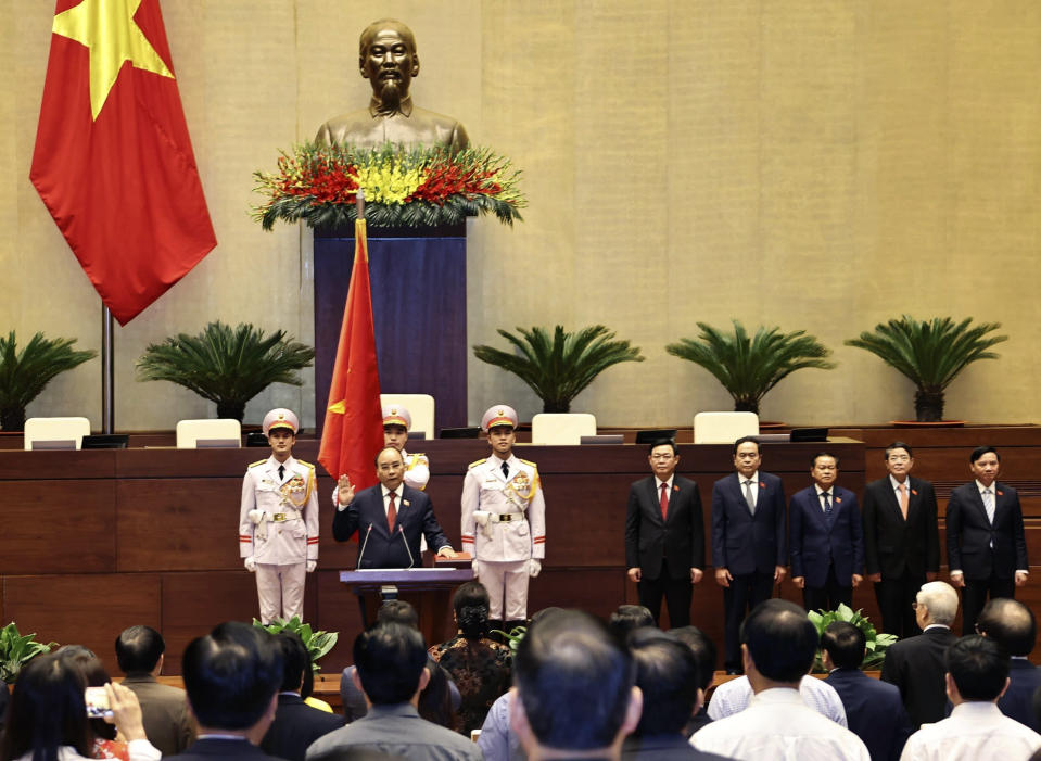 Vietnamese newly elected President Nguyen Xuan Phuc takes an oath in front of the National Assembly in Hanoi, Vietnam on Monday, April 5, 2021. Vietnam's legislature voted Monday to make Pham Minh Chinh, a member of the Communist party's central committee for personnel and organization, the country's next prime minister. Outgoing Prime Minister Nguyen Xuan Phuc was appointed the new president. (Nguyen Trong Duc/ VNA via AP)