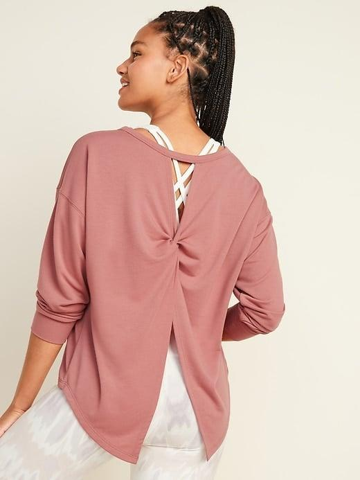 <p>The <span>Old Navy Lightweight French Terry Split-Back Sweatshirt</span> ($25, originally $30) features long drop-shoulder sleeves so you can show off the straps of your favorite workout tank or sports bra underneath. </p>