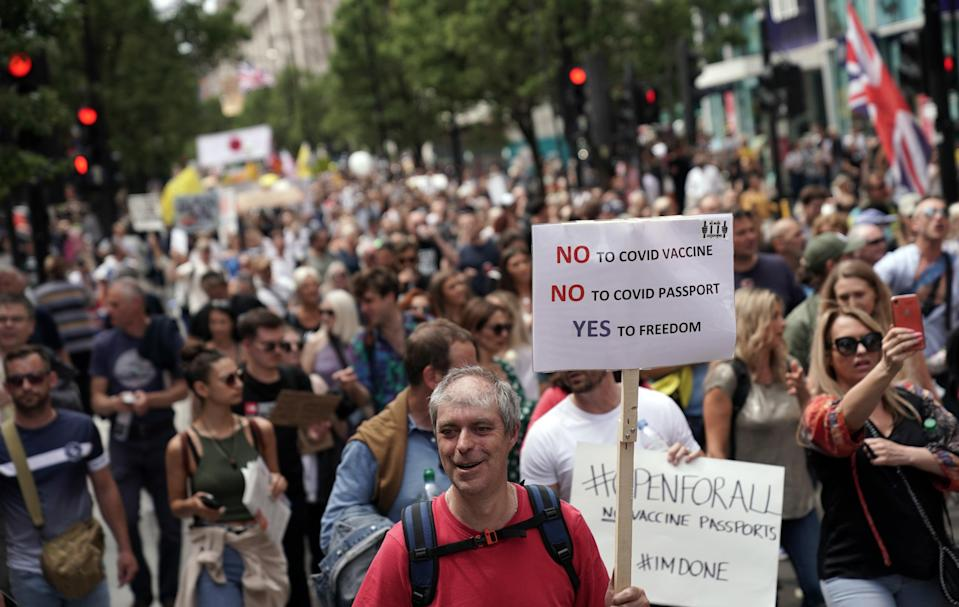 Protesters match down Oxford Street (PA)