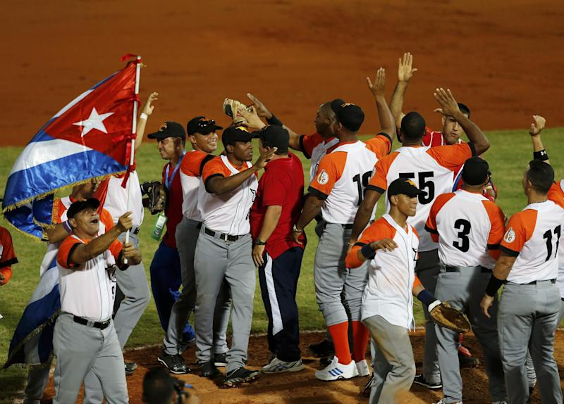 Cuba players celebrate after defeating Puerto Rico 2-1 in a Caribbean Series baseball game in Porlamar, Venezuela, Tuesday, Feb. 4, 2014. (AP Photo/Fernando Llano)
