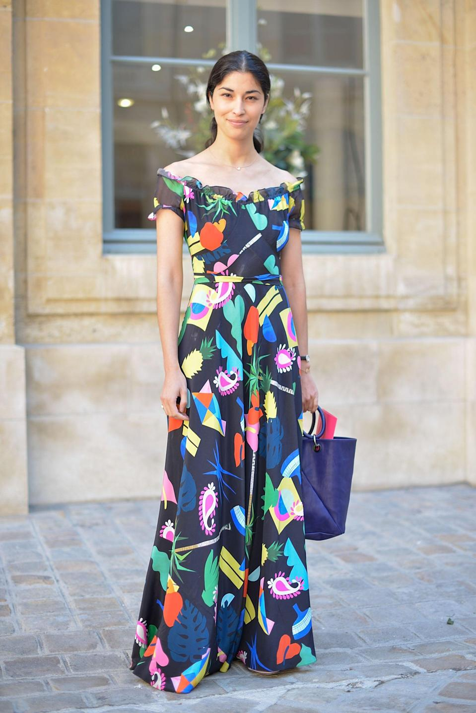 <p>Caroline proves that polished doesn't have to be boring in this off-the-shoulder dress.</p>