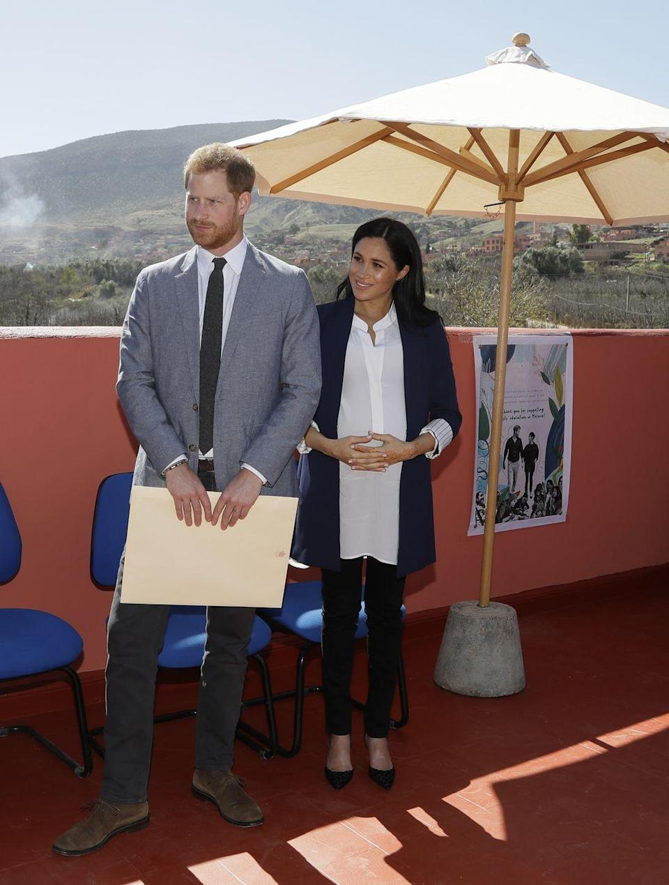"<p>Later in the day the Duke and Duchess of Sussex attend an Investiture of the founder of Education for All. As it was a more formal occasion Meghan changed into Manolo Blahnik heels and a tailored white shirt. </p><p><a class=""link rapid-noclick-resp"" href=""https://go.redirectingat.com?id=74968X1596630&url=https%3A%2F%2Fshop.nordstrom.com%2Fs%2Fmanolo-blahnik-bb-pump-women%2F3434469&sref=https%3A%2F%2Fwww.townandcountrymag.com%2Fstyle%2Ffashion-trends%2Fg3272%2Fmeghan-markle-preppy-style%2F"" rel=""nofollow noopener"" target=""_blank"" data-ylk=""slk:Shop Similar"">Shop Similar</a> <em>BB Pump, Manolo Blahnik, $625 </em> </p>"