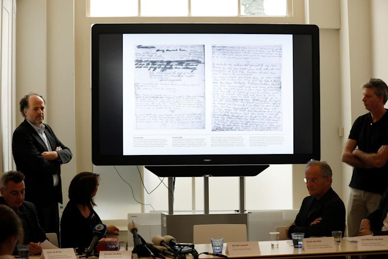 Ronald Leopold (left), executive director of the Anne Frank House, presents two unknown pages of Anne Frank's diary, during a press conference on Tuesday in Amsterdam. (BAS CZERWINSKI via Getty Images)