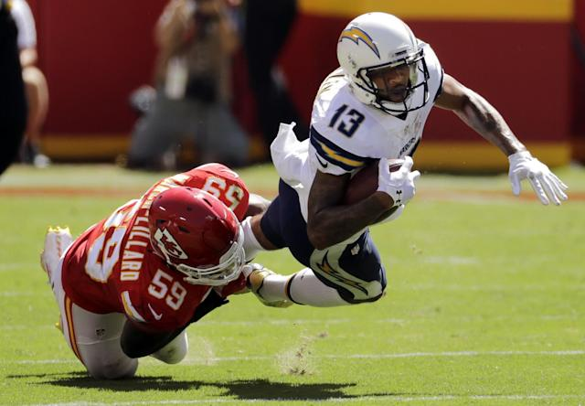 <p>San Diego Chargers wide receiver Keenan Allen (13) is tackled by Kansas City Chiefs linebacker Justin March (59) during the first half of an NFL football game in Kansas City, Mo., Sunday, Sept. 11, 2016. (AP Photo/Charlie Riedel) </p>