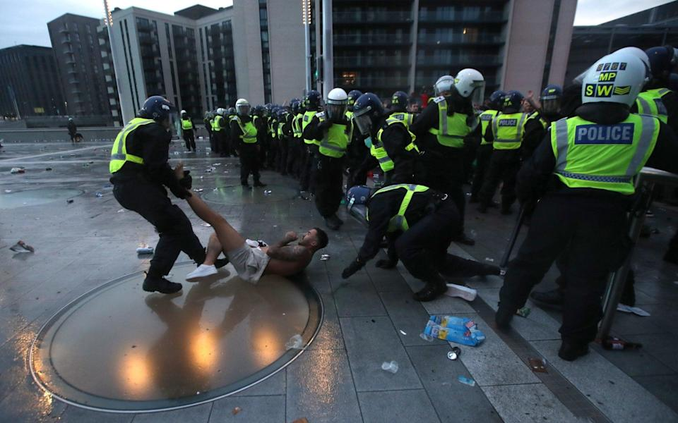 Police detain a so-called England fan - ACTION IMAGES