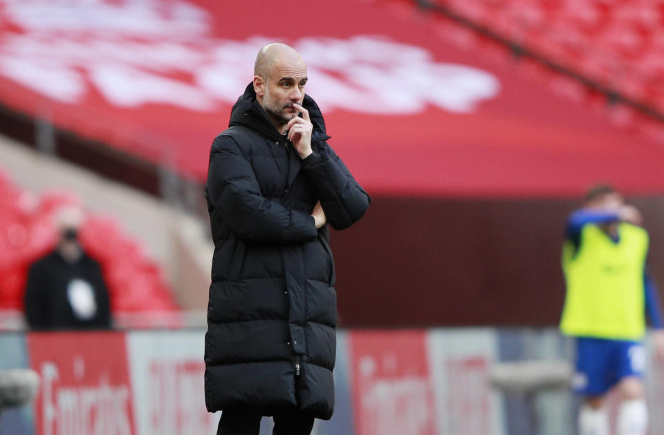 Manchester City's head coach Pep Guardiola stands during the English FA Cup semifinal soccer match between Chelsea and Manchester City at Wembley Stadium in London, England, Saturday, April 17, 2021. (AP Photo/Ian Walton, Pool)