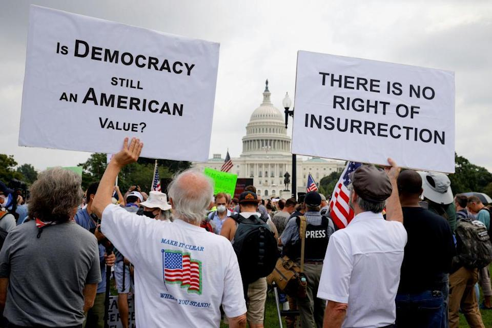 Counter-protesters hold signs during the Justice for J6 rally in Washington DC.