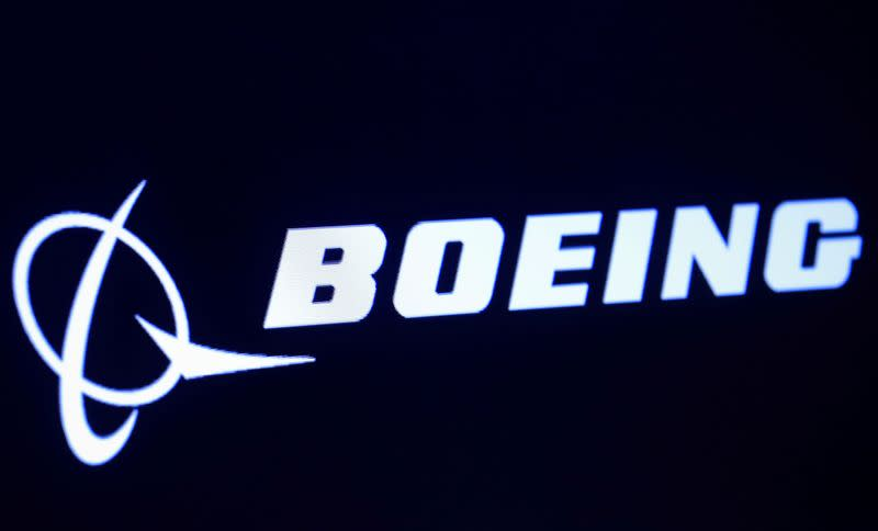 FILE PHOTO: The company logo for Boeing is displayed on a screen on the floor of the NYSE in New York