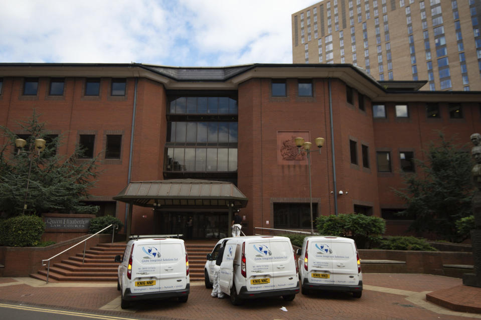 Cleaners arrive Birmingham Crown Court, which has been closed this afternoon and given a deep clean after a staff member reported COVID-19 symptoms overnight, in Birmingham, England, Friday, Sept. 11, 2020. Households in England's second-largest city, Birmingham, are being urged to stop socializing with others from Friday as part of a dramatic tightening of coronavirus restrictions in the wake of a sharp spike in new confirmed cases. (Jacob King/PA via AP)