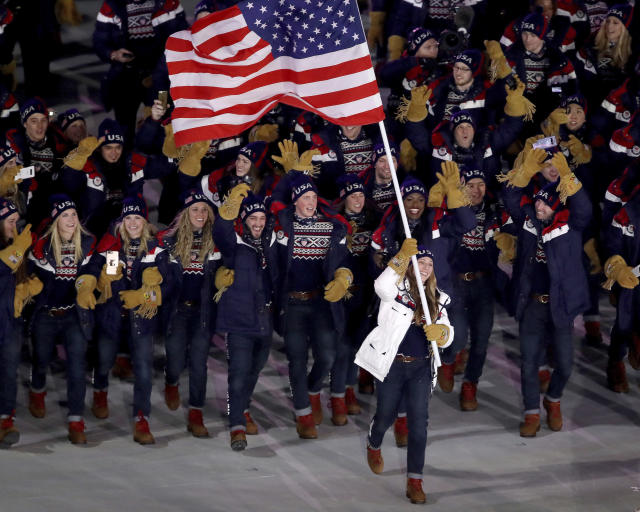 <p>Erin Hamlin carries the flag of the United States during the opening ceremony of the 2018 Winter Olympics in Pyeongchang, South Korea, Friday, Feb. 9, 2018. (Sean Haffey/Pool Photo via AP) </p>