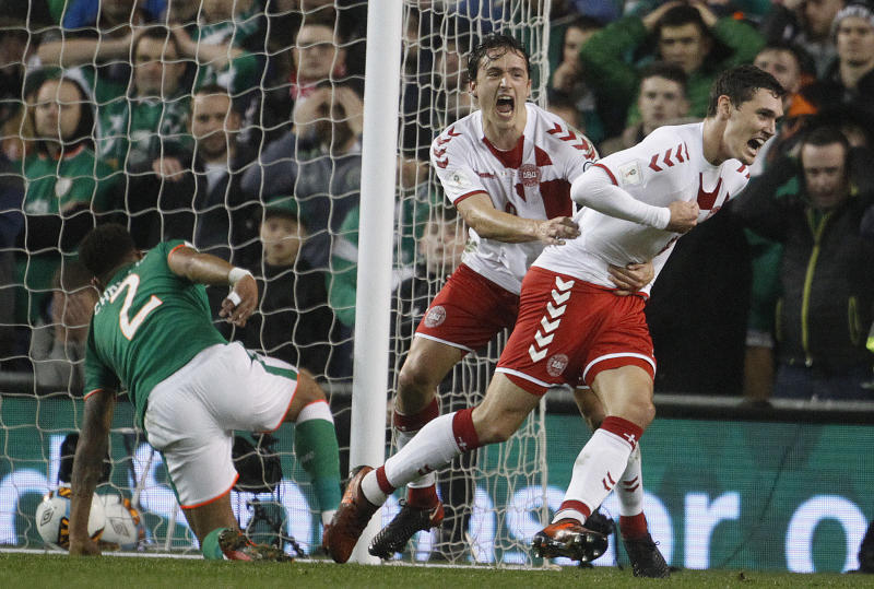 Denmark's Thomas Delaney, left, and Denmark's Andreas Christensen celebrate after scoring during the World Cup qualifying play off second leg soccer match between Ireland and Denmark at the Aviva Stadium in Dublin, Ireland, Tuesday, Nov. 14, 2017. (AP Photo/Peter Morrison)