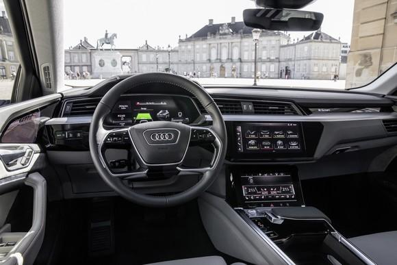 A view of the dashboard of a prototype Audi e-tron. For the most part, it looks like a conventional luxury-car's interior.