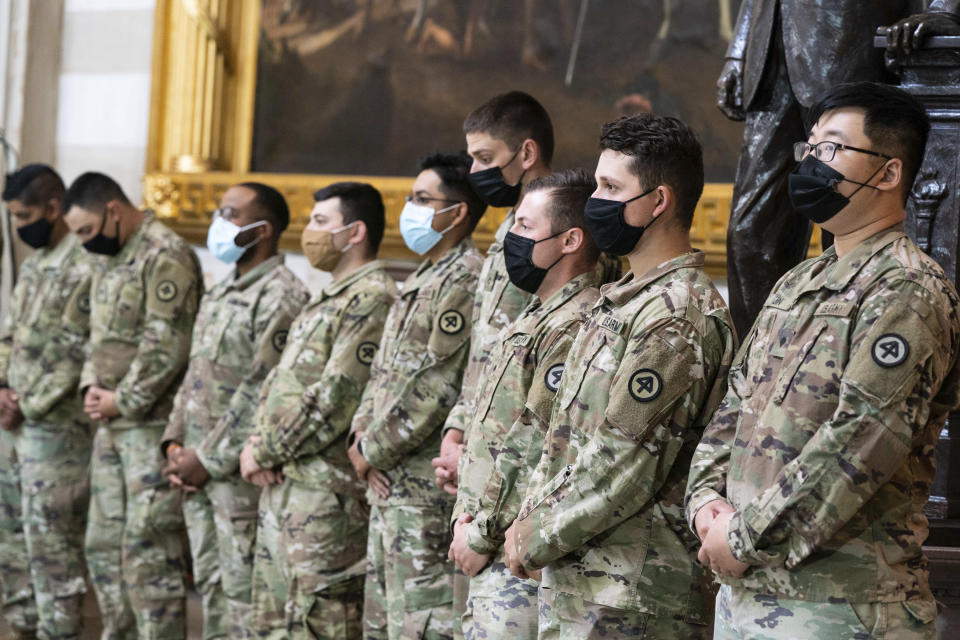 """National Guard troops pay respects to U.S. Capitol Police officer William """"Billy"""" Evans, as Evans lies in honor in the Rotunda at the U.S. Capitol, Tuesday, April 13, 2021 in Washington.(Anna Moneymaker/The New York Times via AP, Pool)"""