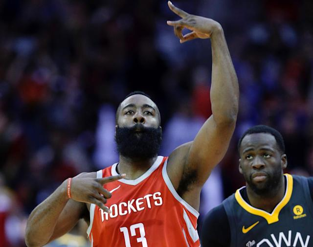 "<a class=""link rapid-noclick-resp"" href=""/nba/players/5069/"" data-ylk=""slk:Draymond Green"">Draymond Green</a> looks on as James Harden celebrates hitting a 3-pointer on Saturday. (AP)"