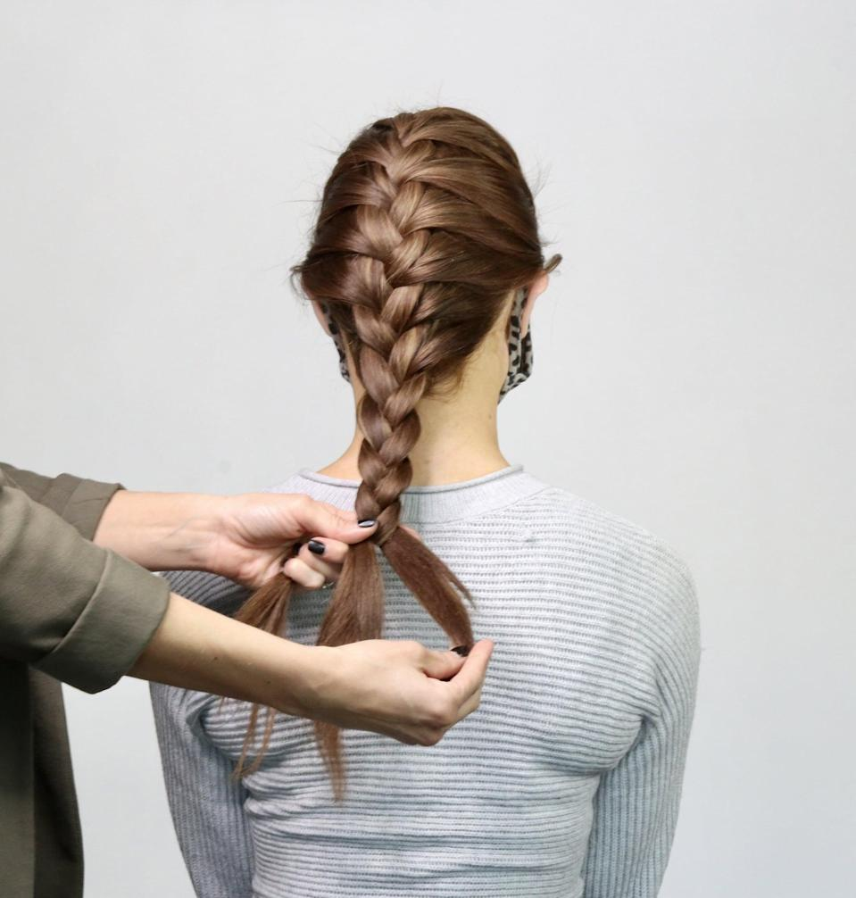 "<p>Once you get to the ponytail portion of hair, take each section and continue ""doing a simple three-strand braid technique"" until you reach the bottom, she said.</p>"