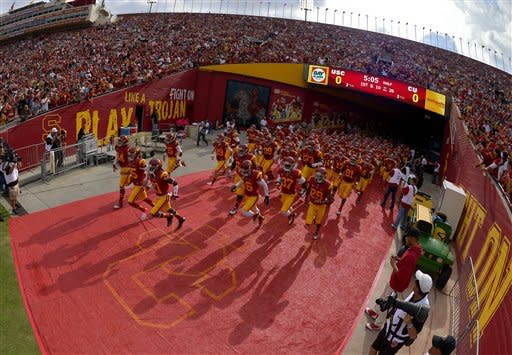 Members of Southern California run out to the field prior to their NCAA college football game against Colorado, Saturday, Oct.20, 2012, in Los Angeles. (AP Photo/Mark J. Terrill)