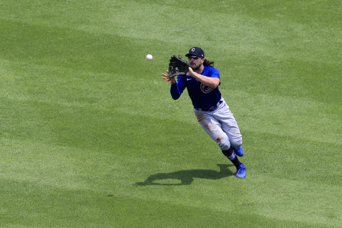 Chicago Cubs' Jake Marisnick (6) fields a fly ball for an out hit by Cincinnati Reds' Tyler Naquin during the fourth inning of a baseball game in Cincinnati, Sunday, July 4, 2021. (AP Photo/Aaron Doster)