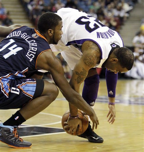 Charlotte Bobcats forward Michael Kidd-Gilchrist (14) and Sacramento Kings guard Marcus Thornton battle for the ball during the first quarter of an NBA basketball game in Sacramento, Calif., Sunday, March 3, 2013. (AP Photo/Rich Pedroncelli)