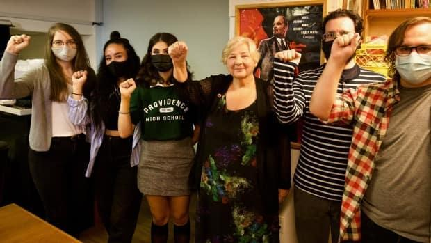 Elizabeth Rowley, centre, poses with party members at the Communist Party of Canada's offices in Vancouver, B.C. The party received a total of 3,905 votes in the 2019 election. (Andrew Lee/CBC - image credit)