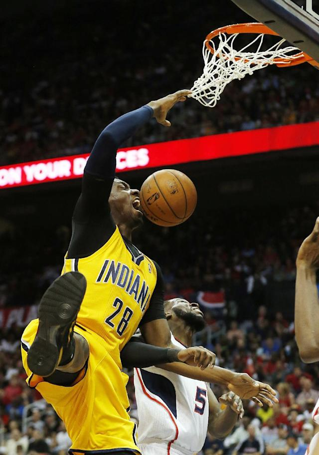 Indiana Pacers center Ian Mahinmi (28) scores as Atlanta Hawks forward DeMarre Carroll (5) defends in the first half of Game 4 of an NBA basketball first-round playoff series, Saturday, April 26, 2014, in Atlanta. (AP Photo/John Bazemore)