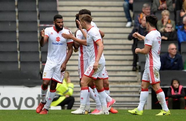 "Soccer Football - League One - Milton Keynes Dons vs Bradford City - Stadium MK, Milton Keynes, Britain - October 7, 2017 MK Dons' Ethan Ebanks-Landell celebrates with team mates after scoring their first goal Action Images/Alan Walter EDITORIAL USE ONLY. No use with unauthorized audio, video, data, fixture lists, club/league logos or ""live"" services. Online in-match use limited to 75 images, no video emulation. No use in betting, games or single club/league/player publications. Please contact your account representative for further details."