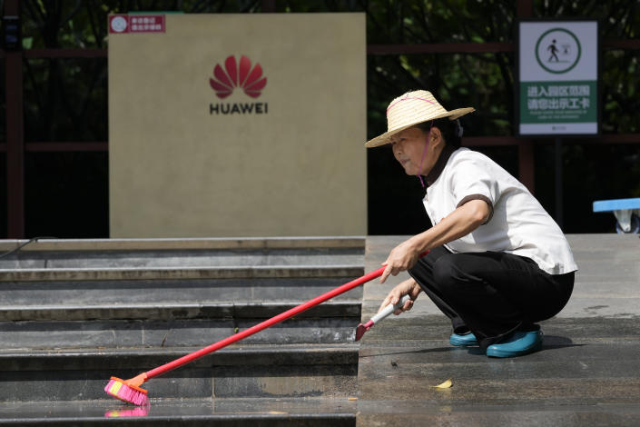 A worker washes the steps outside an entrance to the sprawling Huawei headquarters campus in Shenzhen, China, Saturday, Sept. 25, 2021. Two Canadians detained in China on spying charges were released from prison and flown out of the country on Friday, Prime Minister Justin Trudeau said, just after a top executive of Chinese communications giant Huawei Technologies reached a deal with the U.S. Justice Department over fraud charges and flew to China. (AP Photo/Ng Han Guan)