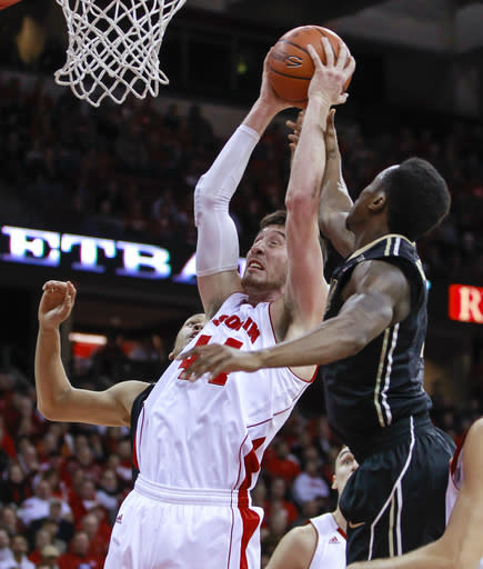 Wisconsin's Frank Kaminsky (44) pulls down a defensive rebound against Purdue's Jon Octues during the first half of an NCAA college basketball game Wednesday, Jan. 7, 2015, in Madison, Wis. (AP Photo/Andy Manis)