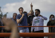 Brazil's Environment Minister, Ricardo Salles talks to supporters at the end of a caravan of motorcycle enthusiasts, organized to show support for President Jair Bolsonaro, in Sao Paulo, Brazil, Saturday, June 12, 2021. (AP Photo/Marcelo Chello)