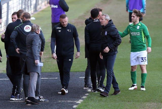 Derby manager Wayne Rooney (centre) and Birmingham counterpart Lee Bowyer after City's 2-1 win at Pride Park secured their Sky Bet Championship status and left the Rams in deep trouble