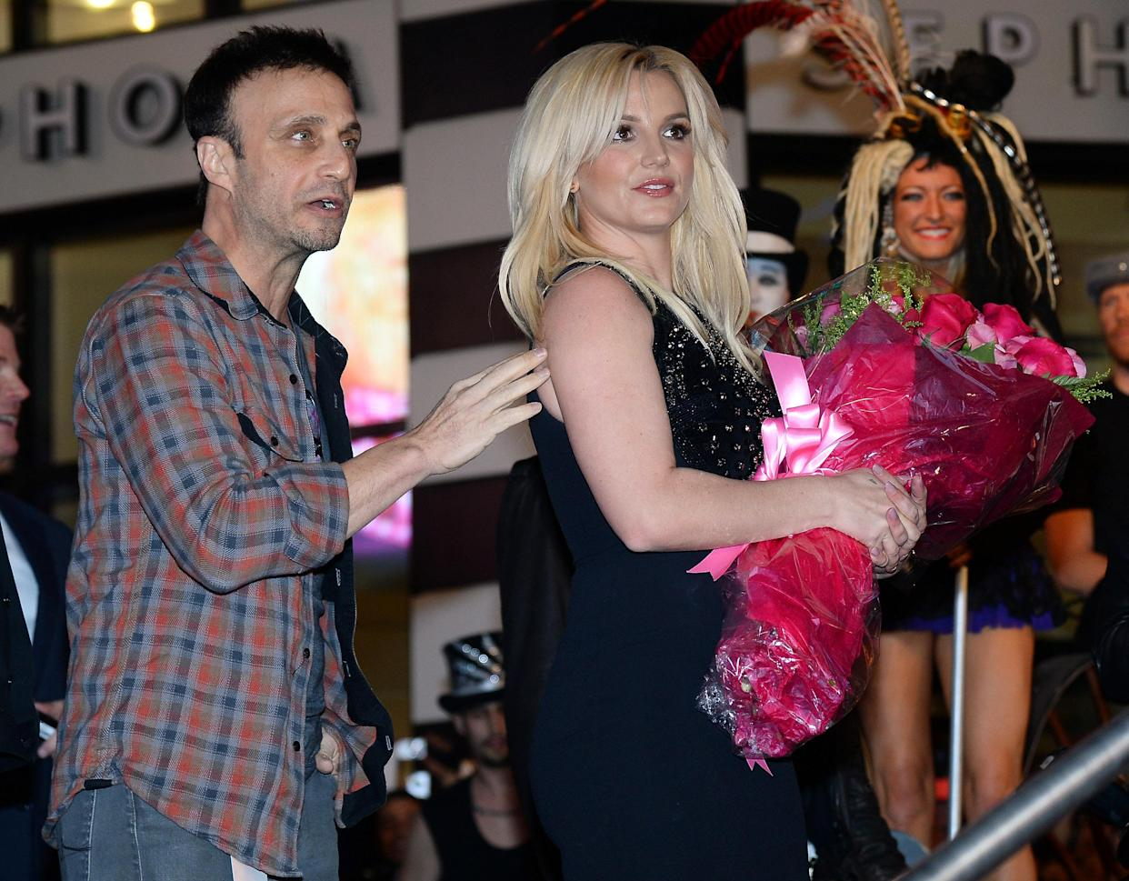 LAS VEGAS, NV - DECEMBER 03:  Singer Britney Spears (R) and her manager Larry Rudolph arrive at a welcome ceremony as Spears celebrates the release of her new album