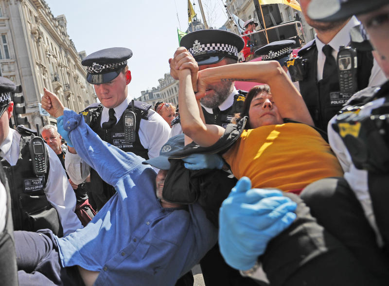 Climate protesters march in London again; arrests hit 710