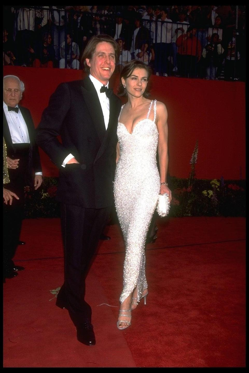 <p>The model and actress dazzled at the Oscars in 1995 wearing a sparkly Versace gown. </p>