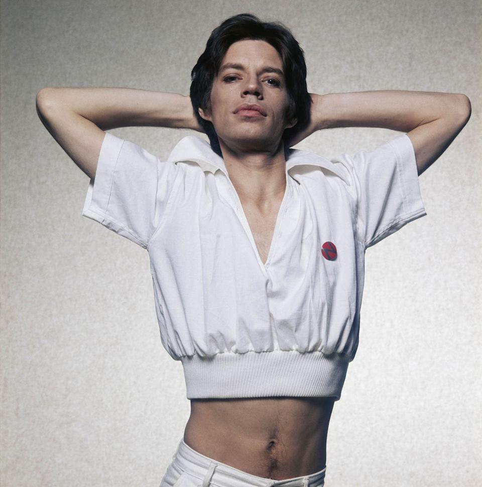<p>Mick Jagger in a white short-sleeved jacket, circa 1975.</p>